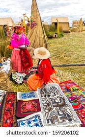 Souvenir on Floating islands Titicaca lake, Peru,South America. Street shop with colorful blanket, scarf, cloth, ponchos,ornaments,