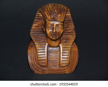 Souvenir pharaoh statue isolated on a dark background