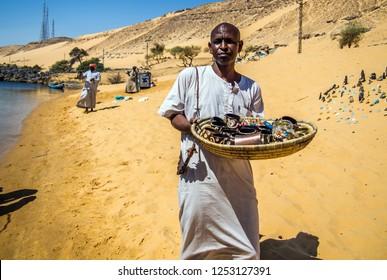 Souvenir seller, Nubia,, Aswan, southern Egypt, August 2014