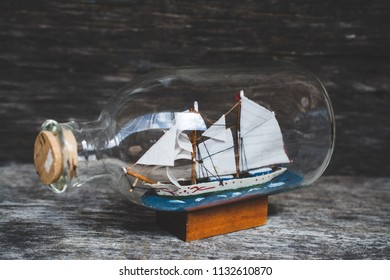 souvenir ship in bottles on the table