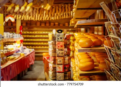 Souvenir shop in Netherlands with cheese and wooden shoes on the shelves. Tradition Holland klompen and clogs