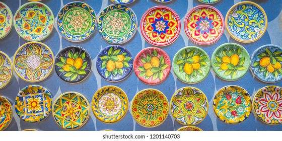 Souvenir from Sicily: fridge magnets with colourful design. Useful for background.