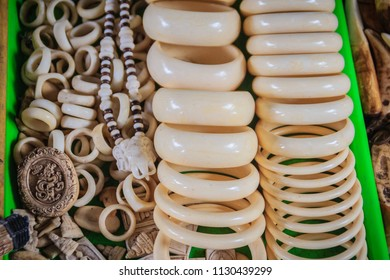 Souvenirs and amulets carved from Ivory for sale at Thai-Cambodia border market.