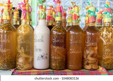 Souvenirs of Caribbean: Assortment of fruit flavored punch in Caribbean market stall. Home made rum based alcoholic drink.