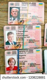 Souvenirs in form Ukrainian driving license with photo of Donald J. Trump,Angela Merkel and Petro Poroshenko on the counter of a street's souvenirs vendor in center of Kiev, Ukraine, 20 October 2018