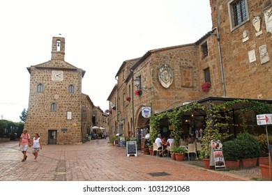 SOVANA, ITALY - JULY 26, 2017: Tourists on central square of Sovana, a medieval village in Grosseto province, Tuscany, Italy.