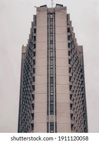 Soviet architecture building in a modern city against the sky