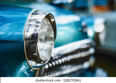 Soviet blue car headlights close-up