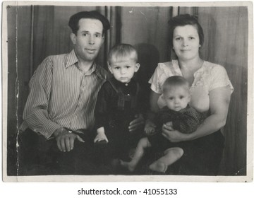 Soviet family, a man with a woman and two sons. USSR, mid 20 century