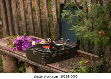 """Soviet gramophone with a vinyl record of the USSR. Memorial record player. The inscription on the plate """"of the Soviet Union in April plant music by Offenbach. Image with selective focus"""