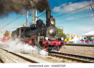 the Soviet locomotive rushes along the ways