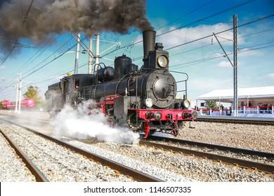 the Soviet locomotive rushes along the ways