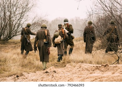 Soviet soldiers of the Red Army of the USSR are walking along the field in the autumn on assignment