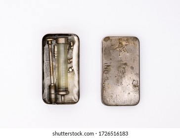 SOVIET UNION - CIRCA 1940s: Old glass syringe with needles in a metal storage box