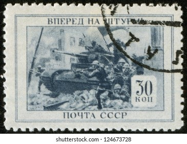 "SOVIET UNION - CIRCA 1945: A stamp printed by the Soviet Union Post is entitled ""Forward To Storm!"", circa 1945"