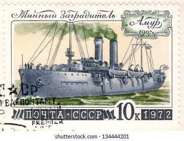 """SOVIET UNION - CIRCA 1972: An old used Soviet Union postage stamp issued in honor of the historical Russian warship minelayer Amur with inscription """"Amur 1907""""; series, circa 1972"""