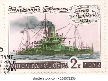 """SOVIET UNION - CIRCA 1972: An old used Soviet Union postage stamp issued in honor of the historical Russian warship battleship """"Peter the Great""""; series, circa 1972"""