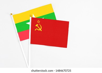 Soviet Union and Myanmar stick flags on white background. High quality fabric, miniature national flag. Peaceful global concept.White floor for copy space.
