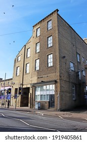 SOWERBY BRIDGE, UK - FEBRUARY 17, 2021: An old mill converted into apartments on Wharfe Street, Calderdale, West Yorkshire - Shutterstock ID 1919405861
