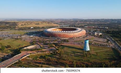 SOWETO, JOHANNESBURG, SOUTH AFRICA - 05 NOVEMBER 2017: The stadium with many names, Soccer City, The Calabash, FNB Stadium, on the morning of the Soweto marathon