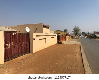 SOWETO, SOUTH AFRICA - 18 SEPTEMBER 2018: A typical residential street in Soweto. Soweto is a township of Johannesburg & its name is an English abbreviation for South Western Townships. Editorial.