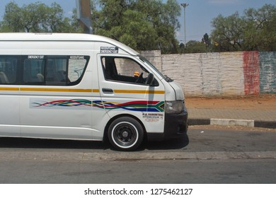 SOWETO, SOUTH AFRICA - CIRCA OCTOBER 2018: Taxi on the side of the road near Johannesburg
