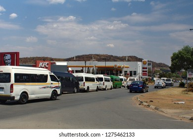 SOWETO, SOUTH AFRICA - CIRCA OCTOBER 2018: Taxis lined up on the side of the road near Johannesburg