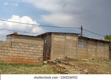 SOWETO, SOUTH AFRICA - CIRCA OCTOBER 2018: Permanent buildings and housing in the township