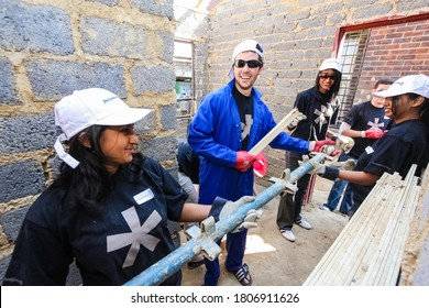 Soweto, South Africa - September 05, 2009: Diverse Community Outreach program helping to build a small affordable house in local township