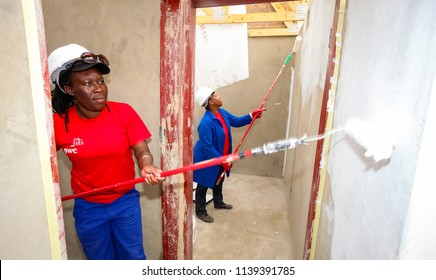 Soweto, South Africa, September 10, 2011, Diverse Community members join PWC's staff in building a low cost house as a team in Soweto