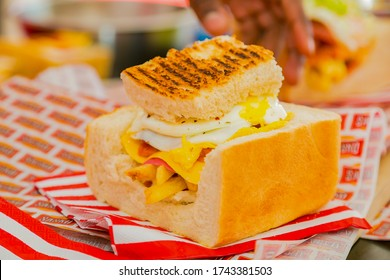 Soweto, South Africa - September 8, 2018: Close up of Traditional African bread based street food called Bunny Chow at outdoor festival