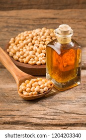 Soy bean and soy oil on wooden table - Glycine max