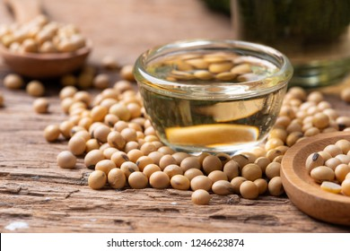 Soy bean and soy oil on wooden table