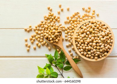 Soy bean on spoon it on white table background with copy space,healthy concept.