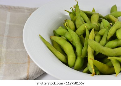 Soy beans in a white bowl