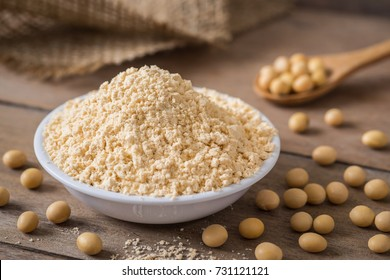 Soy flour in bowl and soybean