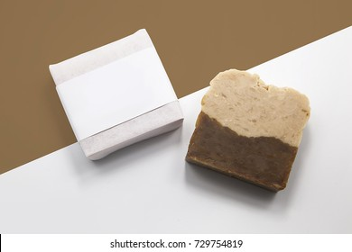 soy milk herb handmade soap in package with two tone background. closeup.