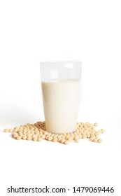 Soy milk with soybeans on white background