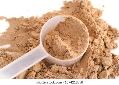 Soy Protein Isolate Powder in a scoop. Close up.