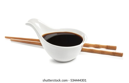 Soy sauce and chopsticks isolated on white background, with clipping path