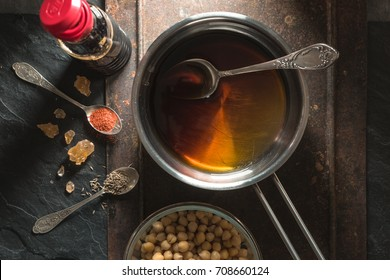 Soy sauce in a saucepan, chickpeas and spices close-up
