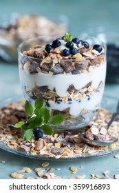 soy yogurt with oat flakes and blueberries