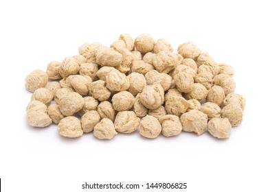 Soya protein chunks isolated on a white background. Vegan and diet food.