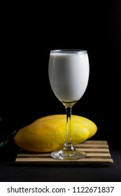 soybean milk and mango isolate on black background