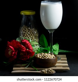 soybean milk and soybean seed and Flower isolate on black background