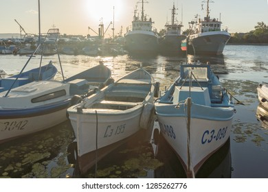 SOZOPOL, BULGARIA - AUGUST 9, 2018: Sunset seascape with Boat at port of Sozopol, Burgas Region, Bulgaria