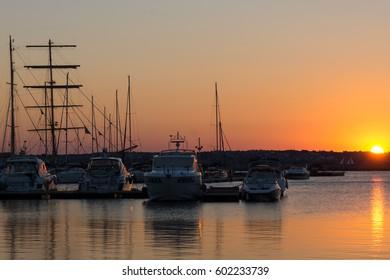 SOZOPOL, BULGARIA - JULY 11, 2016: Amazing Sunset at the port of Sozopol, Burgas Region, Bulgaria