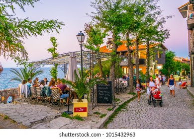 SOZOPOL, BULGARIA, JULY 31, 2017: People are enjoying dinner during sunset in sozopol, Bulgaria.