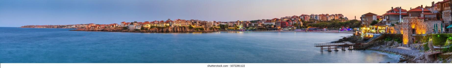 Sozopol, Bulgaria, September 13, 2017. Seaside landscape, panorama, banner - view of the embankment with fortress wall during sunset in Sozopol on the Black Sea coast in Bulgaria.