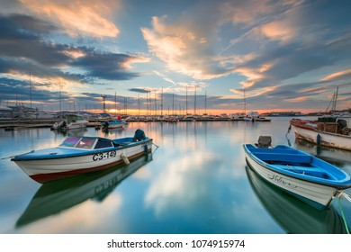 SOZOPOL - March 31 2018: fishing boats at sunset on March 31 2018 in Sozopol, Bulgaria. Fishing boats docked near embankment in port of town Sozopol (former ancient town of Apollonia),  at sunset.